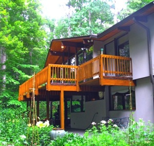 This photo shows a Balcony Deck built to Deck House Standards. The girders which support the 3x6 Cedar Decking are apart on 8' centers. The same girders also support the cantilevered elements of the upper floor photo from Triangle Modernist Houses The Williamson House in Raleigh North Carolina