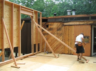 Carpenter working on a combined renovation and addition to a Deck House in Pound Ridge, NY.