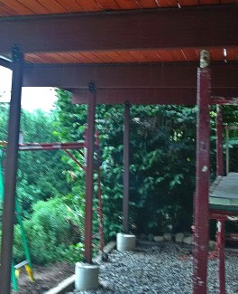 In this photo the metal drip edge at the top of the girders can be seen. The girders have been primed two coats with a high quality adhesion primer and the posts are sealed and stained. The Decking was pre-finished using Duckback Superdeck.