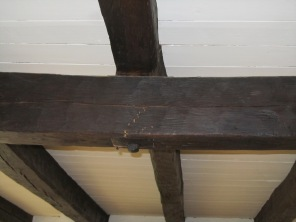 Cracked main girder in post and beam ceiling in old farmhouse Harrison NY