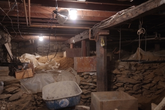 Old basement girder probably reclaimed barn timber preparations for shoring underway